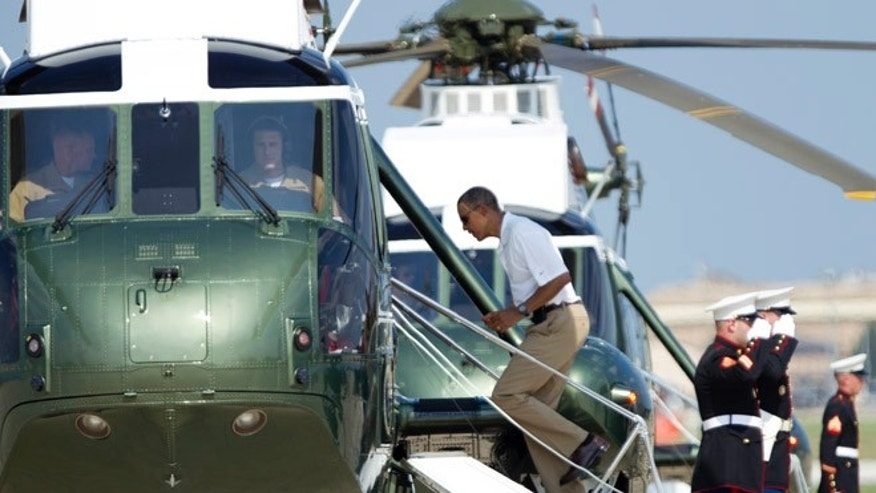 Aug. 4, 2012: President Barack Obama boards Marine One helicopter as he departs Andrews Air Force Base, Md., for Camp David.
