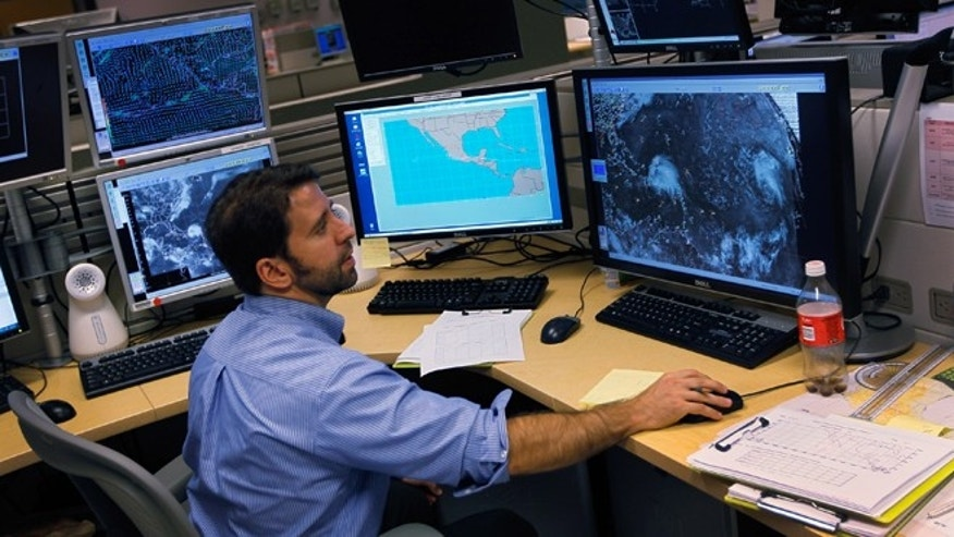 MIAMI, FL - AUGUST 22:  Todd Kimberlain a hurricane forcaster studies computer models as he tracks Hurricane Irene at the National Hurricane Center on August 22, 2011 in Miami, Florida. Irene is the first Hurricane of the 2011 Atlantic season with winds at 80mph currently and may hit the East coast later this week with higher winds projected.  (Photo by Joe Raedle/Getty Images)