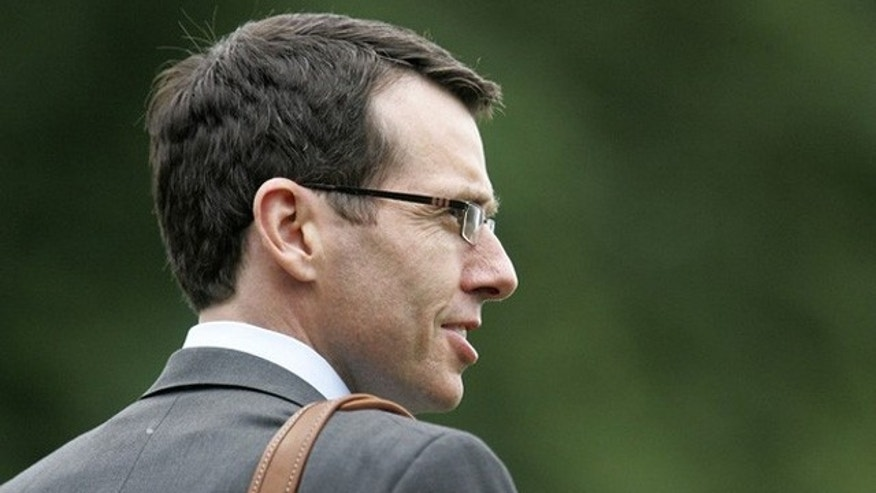 Jun 14, 2012: White House senior adviser David Plouffe walks to the Marine One helicopter to depart from Washington.