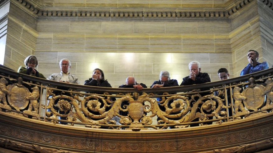 "March 29, 2010: Participants in the ""Show Me Your Glory Lord!"" service pray in the State Capitol in Jefferson City, Mo."