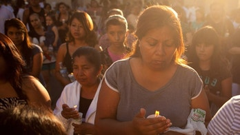 ANAHEIM, CA - JULY 29: Local residents gather for a candle light vigil for Manuel Angel Diaz, 25, on July 29, 2012 in Anaheim, California. Diaz was fatally shot July 21 by an Anaheim police officer and has sparked days of protests by the angered community. (Photo by Jonathan Gibby/Getty Images)