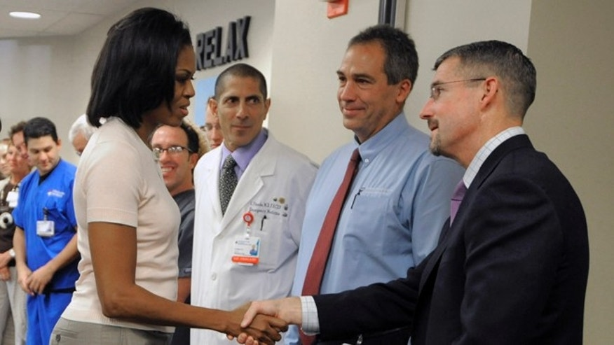 Aug. 11: First lady Michelle Obama shakes hands with Dr. James Denton, a first responder to the Aurora theater shooting, at The Medical Center of Aurora.