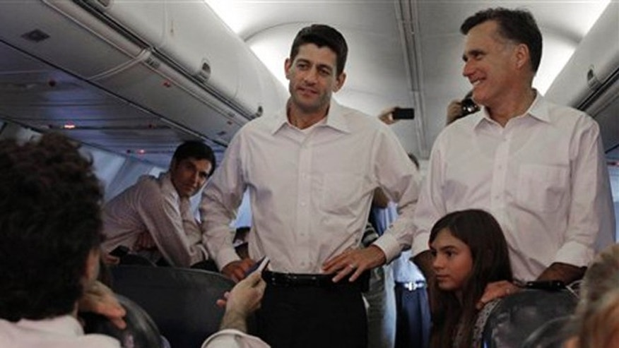 Aug. 11, 2012: Mitt Romney, right, and VP mate Rep. Paul Ryan, R-Wis. are joined by Romney's granddaughter Chloe on a flight between Virginia and North Carolina.