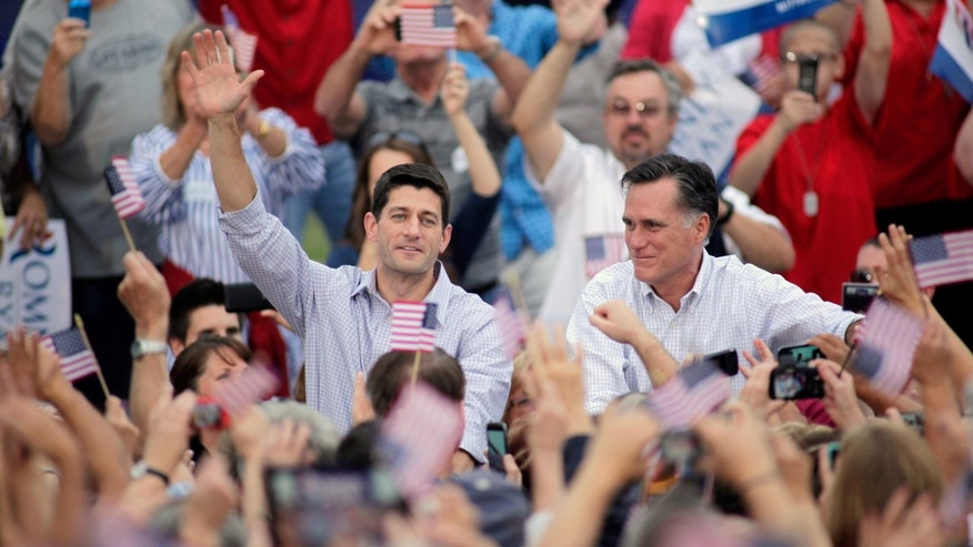 WAUKESHA, WI - AUGUST 12: Republican presidential candidate and former Massachusetts Gov. Mitt Romney and vice presidential candidate and Wisconsin native Rep. Paul Ryan (R-WI) (L) greet supporters during a campaign event at the Waukesha Expo Center on August 12, 2012 in Waukesha, Wisconsin. Romney continues his four day bus tour a day after announcing his running mate, Rep. Paul Ryan. (Photo by Darren Hauck/Getty Images)