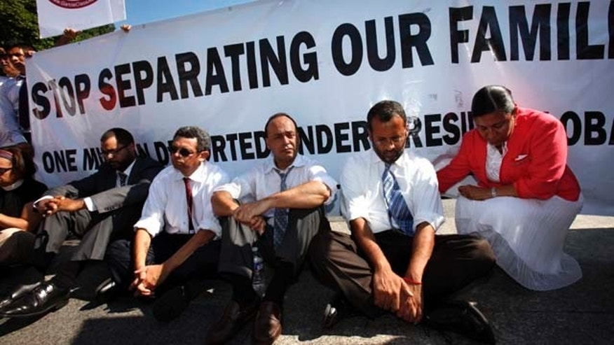 Supporters, including Rep. Luis Gutierrez, D-Ill., third from right, participate in an act of civil disobedience at a rally in 2011 for immigration reform and a pathway to legalization for undocumented immigrants.