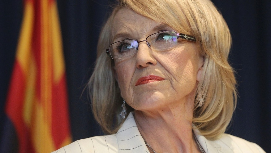 June 25, 2012: Arizona Governor Jan Brewer listens to a question from a media member about the Supreme Court's decision on SB1070 in Phoenix, Arizona.
