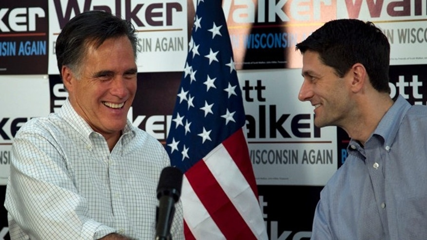 March 31, 2012: Republican presidential candidate, former Massachusetts Gov. Mitt Romney, left, shakes hands with U.S. Rep. Paul Ryan, R-Wis., Chairman of the House Budget Committee, right, before speaking with supporters of Wisconsin Republican Gov. Scott Walker at a phone bank during a campaign stop in Fitchburg, Wis.
