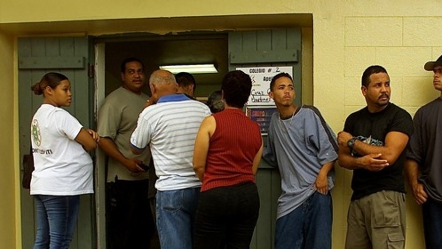 392573 02: (Puerto Rico Out) Vieques Residents Line Up At Polling Stations To Cast Their Vote In A Non- Binding Referendum Over The Future Of Navy Bombing Exercises July 29, 2001 On The Island Of Vieques. Puerto Rico. Option Two Calls For The Immediate And Permanent Termination Of Military Exercises Plus The Cleaning And Return Of Vieques Land To Its Citizens.  (Photo By Jose Jimenez/Primera Hora/Getty Images)