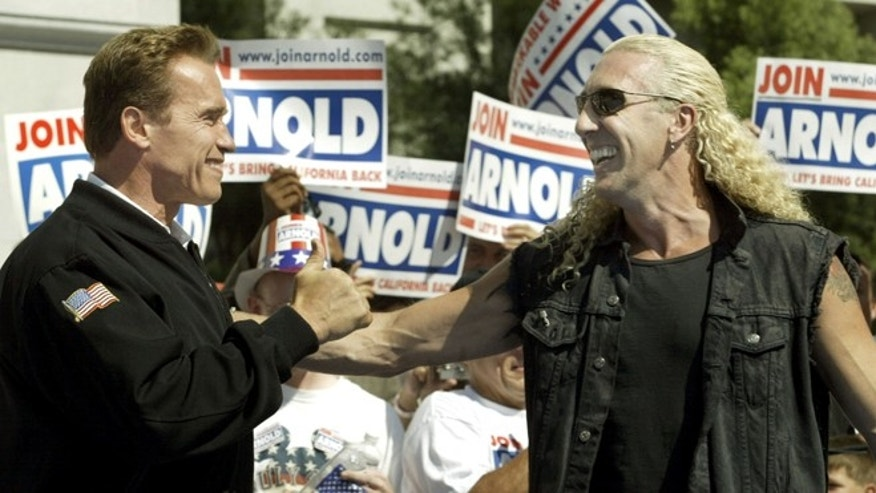 """Oct. 5, 2003: Actor and Republican gubernatorial candidate Arnold Schwarzeneggergreets Twisted Sister lead singer Dee Snider, after the band played""""We're Not Gonna Take It Anymore"""" at a rally on the south steps of theCapitol, in Sacramento."""