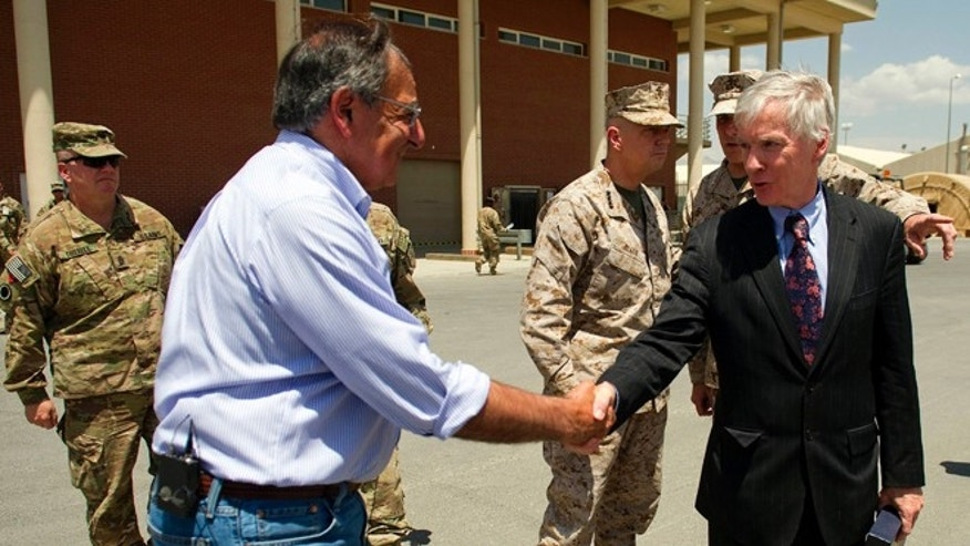 June 7, 2012: US Ambassador to Afghanistan Ryan Crocker, right, shakes hands with US Secretary of Defense Leon Panetta before departing Kabul International Airport.
