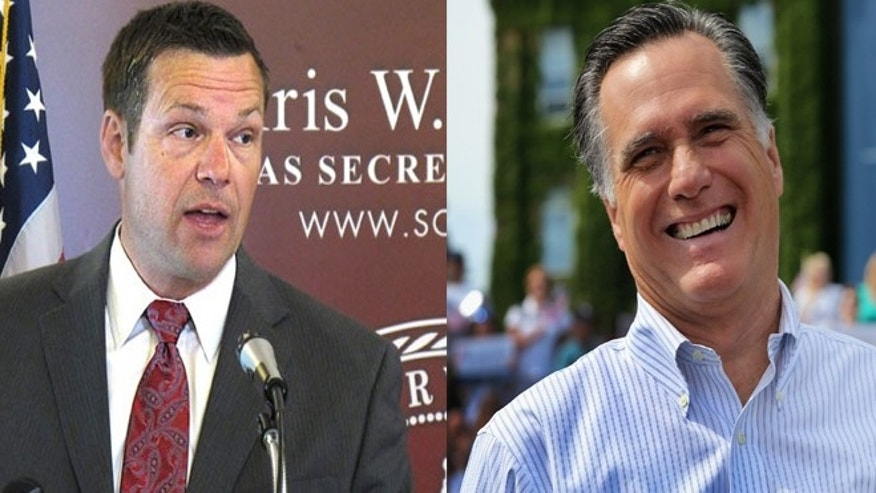 Kansas Secretary of State Kris Kobach, left; presumptive GOP presidential nominee Mitt Romney, right