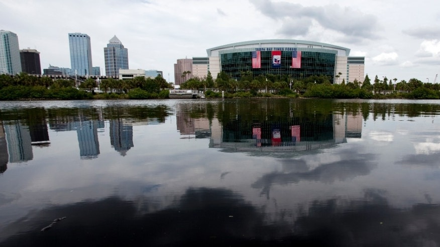 In this photo taken Aug. 22, 2012, the Tampa Bay Times Forum, site of the 2012 Republican National Convention, is viewed across the water of the Garrison Channel from Harbour Island in downtown Tampa, Fla. Weather forecasts continue to show Florida in the path of Tropical Storm Isaac. (AP Photo/The Tampa Bay Times, Carolina Hidalgo) TAMPA OUT; CITRUS COUNTY OUT; PORT CHARLOTTE OUT; BROOKSVILLE HERNANDO OUT; USA TODAY OUT; MAGS OUT