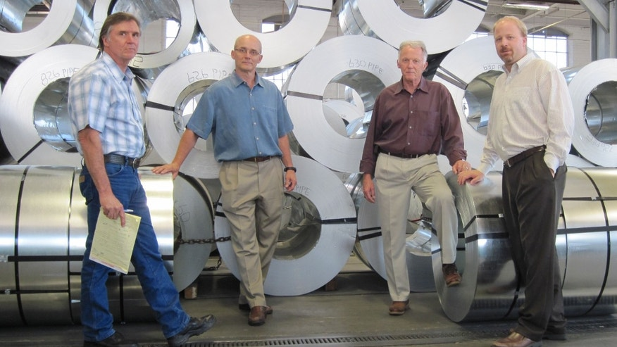 The owners of Hercules Industries -- from left to right, James Newland, Paul Newland, William Newland, Andrew Newland -- won an injunction to stop the Obama administration's health care mandate that requires employers provide coverage for abortion-inducing drugs, sterilization and contraception -- a requirement they say violates their Catholic beliefs. (Courtesy: ADFMedia.org)