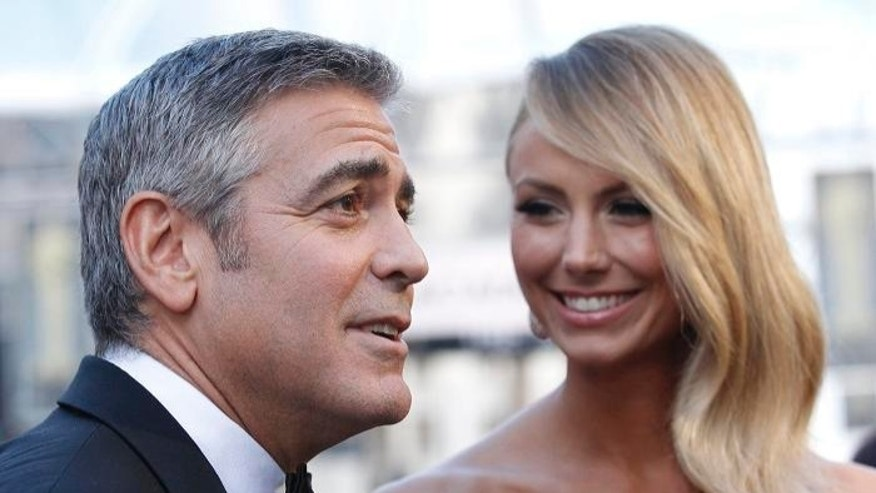 FILE: George Clooney with girlfriend Stacy Keibler at the 84th Academy Awards in Hollywood, Calif.