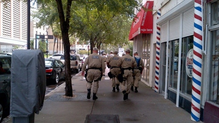 Aug. 27, 2012: Florida State Troopers walk the streets of downtown Tampa.