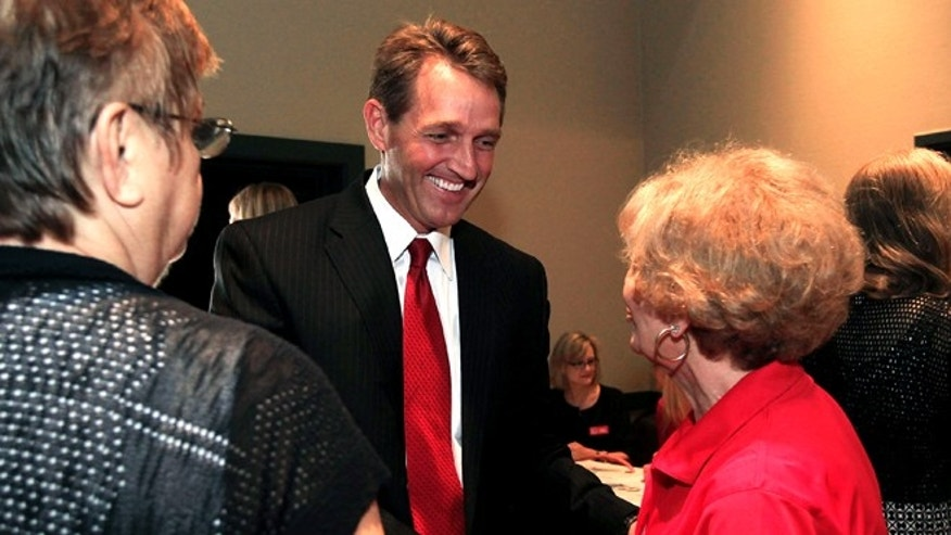 FILE: Aug. 14, 2012: Arizona Republican Senate candidate Rep. Jeff Flake, middle, meets with the Ahwatukee Republican Women group at a candidates forum in Phoenix.