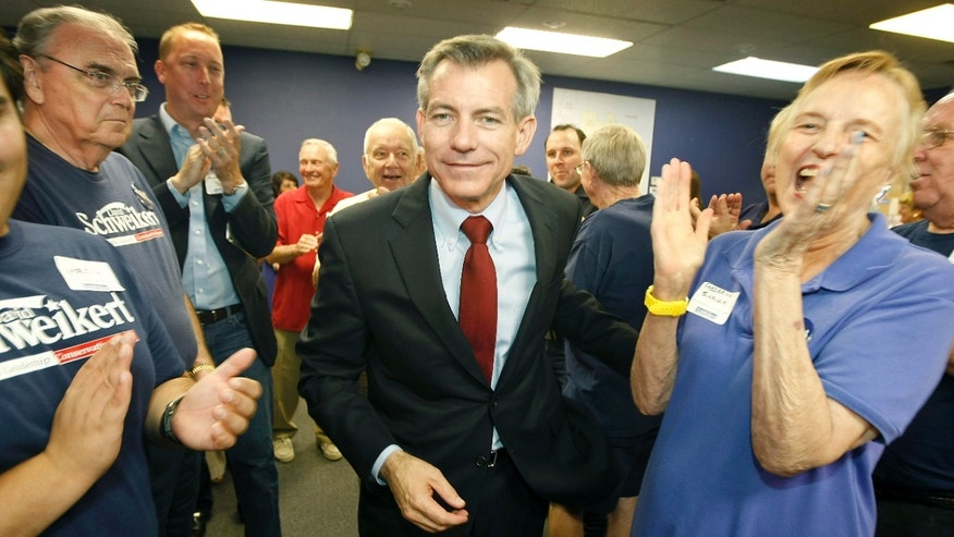 Aug. 28, 2012: Congressional District 6 candidate Rep. David Schweikert, R-Arizona, walks through a crowd of applauding supporters at his campaign headquarters in Phoenix after being declared the winner in his election primary over opponent Rep. Ben Quayle.