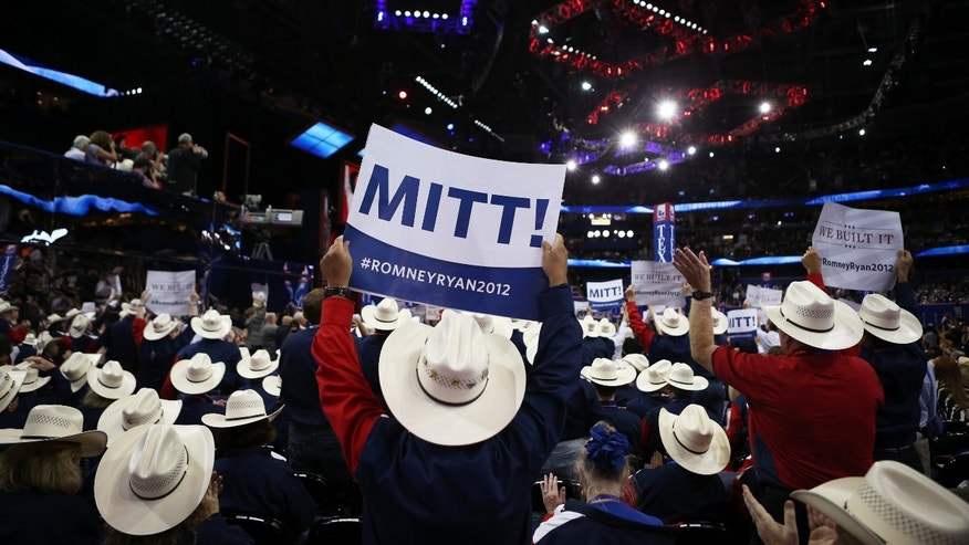 "TAMPA, FL - AUGUST 28:  People from the Texas delegation hold signs that say  ""Mitt!"" during the Republican National Convention at the Tampa Bay Times Forum on August 28, 2012 in Tampa, Florida. Today is the first full session of the RNC after the start was delayed due to Tropical Storm Isaac.  (Photo by Chip Somodevilla/Getty Images)"