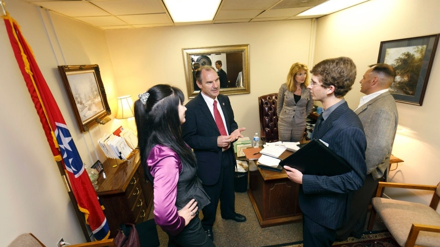 FILE: April 4, 2012: Members of the Tea Party and Young Republicans at Tennessee Technological University  meet with Rep. Mark Pody in his office in Nashville, Tenn.