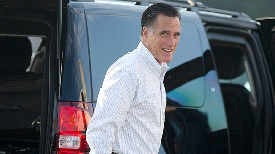 Sept. 7, 2012: Republican presidential candidate, former Massachusetts Gov. Mitt Romney boards his campaign plane for an event in Iowa on Friday in Portsmouth, N.H.  (AP)