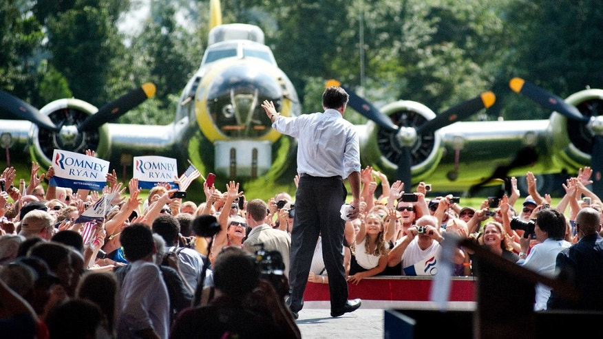 September 8, 2012: Mitt Romney bids farewell to the audience after campaigning at the Military Aviation Museum in Virginia Beach, Va.