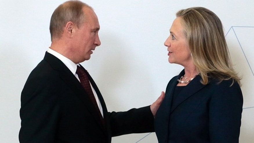 Sept. 8, 2012: Russian President Vladimir Putin, left, meets U.S. Secretary of State Hillary Rodham Clinton on her arrival at the APEC summit in Vladivostok, Russia.
