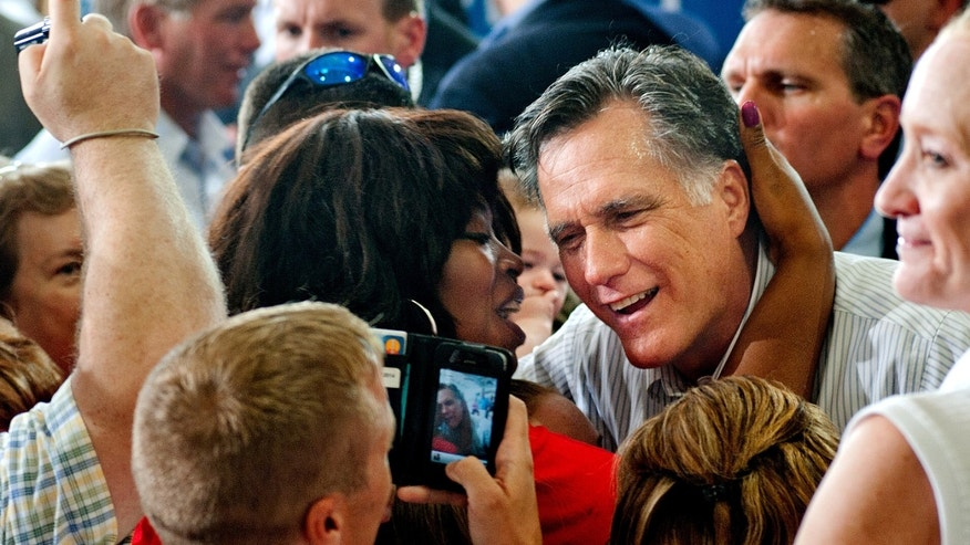 Saturday, Sept. 8, 2012: Mitt Romney is greeted by a supporter after speaking at a rally at the Military Aviation Museum in Virginia Beach, Va.