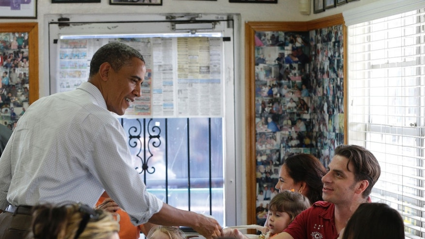 Sept. 8, 2012: President Barack Obama talks to patrons at the West Tampa Sandwich Shop and Restaurant, in Tampa, Fla.