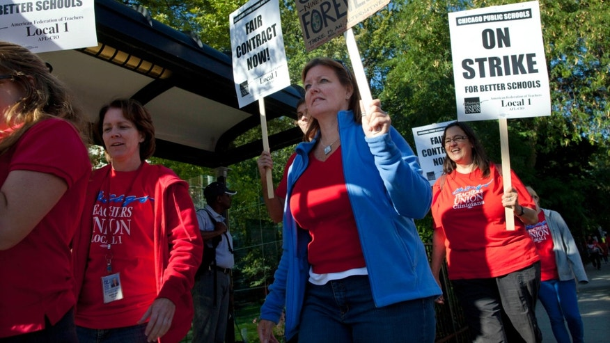 Public school teachers picket outside Amundsen High School on the first day of a strike by the Chicago Teachers Union, Monday, Sept. 10, 2012, in Chicago. (AP Photo/Sitthixay Ditthavong)