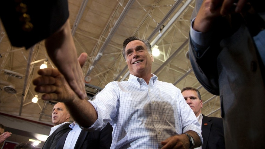 Sept. 7, 2012: Republican presidential candidate, former Massachusetts Gov. Mitt Romney shakes hands during a campaign rally in Orange City, Iowa.