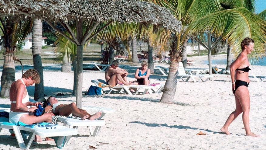387101 14: Sun bathers relax on Giron Beach March 24, 2001 at the Bay of Pigs 150 kilometers (90 miles) south of Havana, Cuba. Playa Giron is now an international tourist center 40 years after the U.S invation here. (Photo by Jorge Rey/Newsmakers)