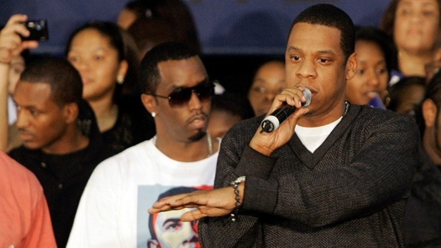 Nov. 2, 2008: File photo shows Jay-Z, right, speaking to Sen. Barrack Obama, D-Ill., supporters as Diddy, center, and Russell Simmons, left, look on during a campaign rally for then-Democratic presidential candidate Sen. Barack Obama in Miami. President Barack Obama's re-election campaign is getting a boost from pop stars Beyonce and Jay-Z. The superstar couple will hold a fundraiser with Obama on Tuesday at a swanky New York nightclub that Jay-Z owns.