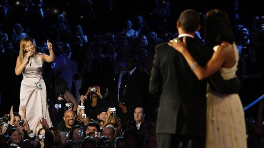 Jan. 20, 2009: File photo shows Beyonce,left,  singing as President Barack Obama and first lady Michelle Obama finish their dance at the Neighborhood Inaugural Ball in Washington. President Barack Obama's re-election campaign is getting a boost from pop stars Beyonce and Jay-Z. The superstar couple will hold a fundraiser with Obama on Tuesday at a swanky New York nightclub that Jay-Z owns.