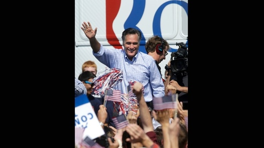 Sept. 13, 2012: Republican presidential candidate, former Massachusetts Gov. Mitt Romney waves to supporters during a campaign event at Van Dyck Park in Fairfax, Va.