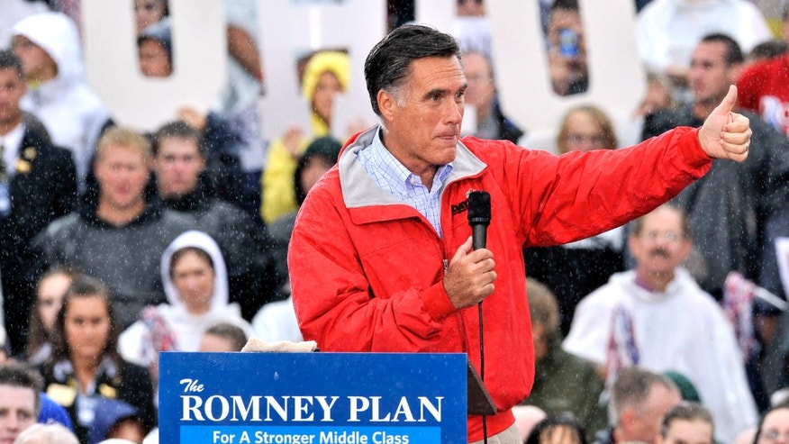 Sept. 14, 2012: Mitt Romney campaigns in the rain at Lake Erie College in Painesville, Ohio.