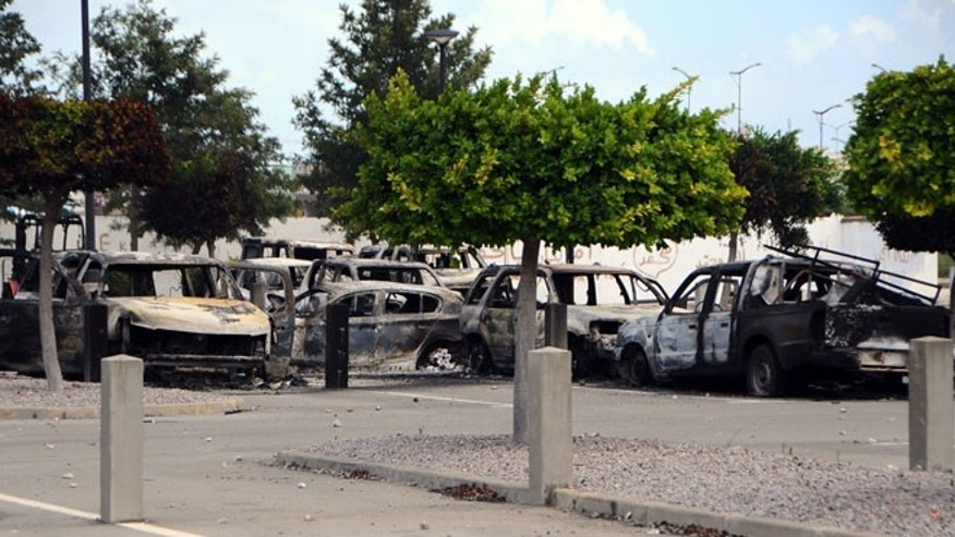 Sept. 15, 2012: View of several dozen burned cars in the parking lot of the U.S. Embassy, a day after several thousand demonstrators angry over a film that insults the Prophet Muhammad stormed the compound, Tunis, Tunisia.