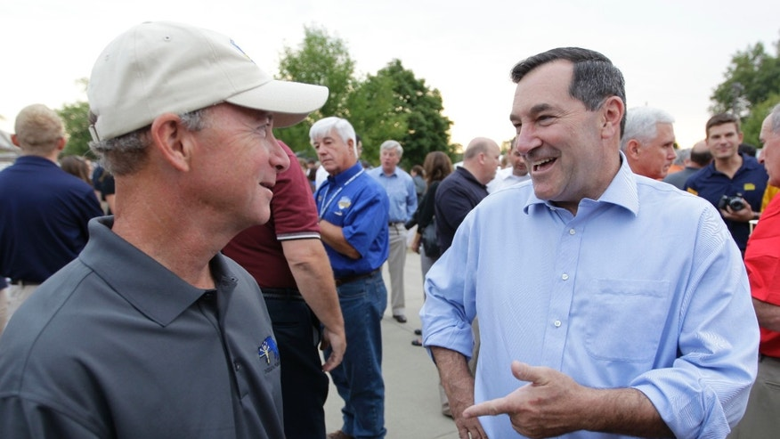 FILE: Aug. 3, 2012: Indiana Gov. Mitch Daniels, left, chats with Rep. Joe Donnelly, D-Ind., at the state fair in Indianapolis.