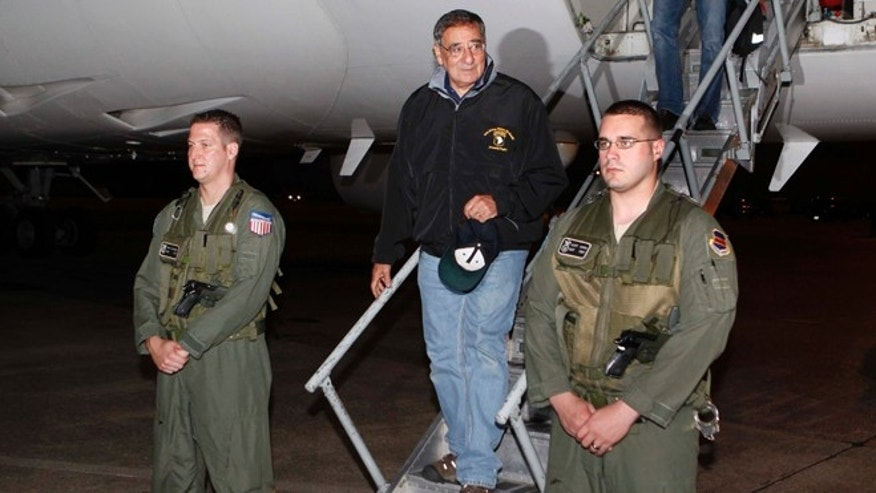 Sept. 16, 2012: U.S. Defense Secretary Leon Panetta, center,  steps off his jet after arriving at Yokota Air Base on the outskirts of Tokyo, Japan.