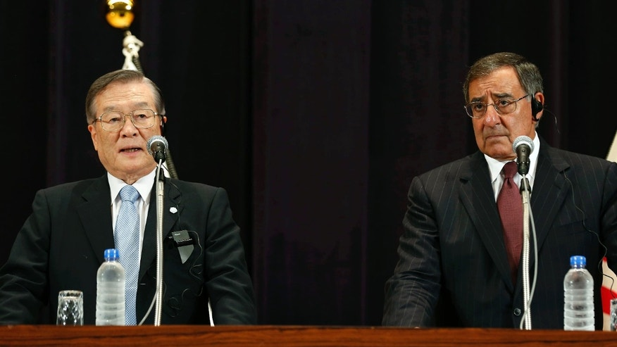 Sept. 17, 2012: U.S. Secretary of Defense Leon Panetta, right, and Japan's Defense Minister Satoshi Morimoto hold a joint news conference at the Ministry of Defense in Tokyo.