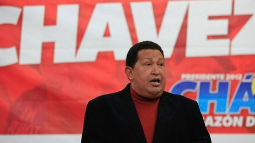 Venezuelaâs President Hugo Chavez speaks during a news conference as presidential candidate for the United Socialist Party of Venezuela in Caracas, Venezuela, Tuesday, Sept. 11, 2012. Chavez is running for another term in Venezuela's Oct. 7 elections. (AP Photo/Ariana Cubillos)
