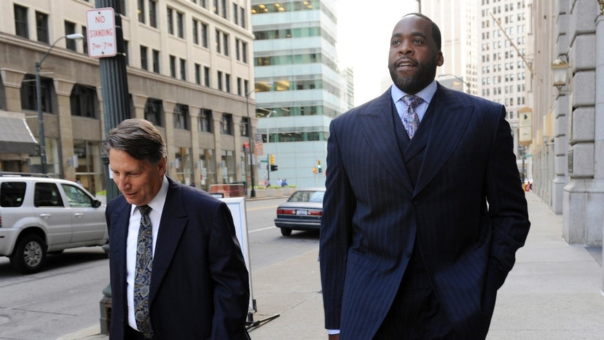 Sept. 6, 2012  - FILE photo of former Detroit Mayor Kwame Kilpatrick walking to federal court in Detroit with attorney Jim Thomas.