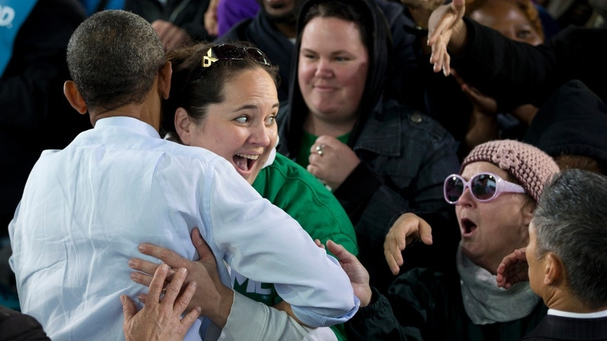 Saturday, Sept. 22, 2012: President Obama is hugged by a woman as he greets people at a campaign event in Milwaukee.