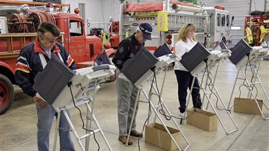 FILE: Nov. 8, 2011: Voters cast their ballots at the Wakeman Township fire station near Wakeman, Ohio