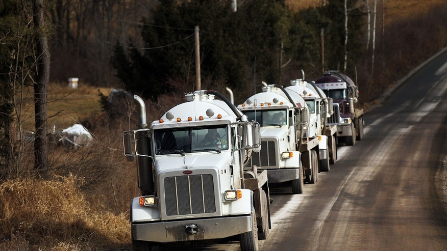 SPRINGVILLE, PA - JANUARY 18: Trucks with the natural gas industry, some of the thousands that pass through the area daily, drive through the countryside on January 18, 2012 in Springville, Pennsylvania. Hydraulic fracturing, also known as fracking, stimulates gas production by injecting wells with high volumes of chemical-laced water in order to free-up pockets of natural gas below. The process is controversial with critics saying it could poison water supplies, while the natural-gas industry says it's been used safely for decades. While New York State has yet to decide whether to allow fracking, economically struggling Binghamton has passed a drilling ban which prohibits any exploration or extraction of natural gas in the city for the next two years. The Marcellus Shale Gas Feld extends through parts of New York State, Pennsylvania, Ohio and West Virginia and could hold up to 500 trillion cubic feet of natural gas.  (Photo by Spencer Platt/Getty Images)