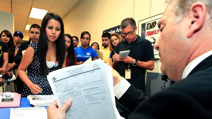 Schools and consulates have been flooded with requests for documents after President Barack Obama announced a new program allowing undocumented immigrants to apply for two-year renewable work permits.
