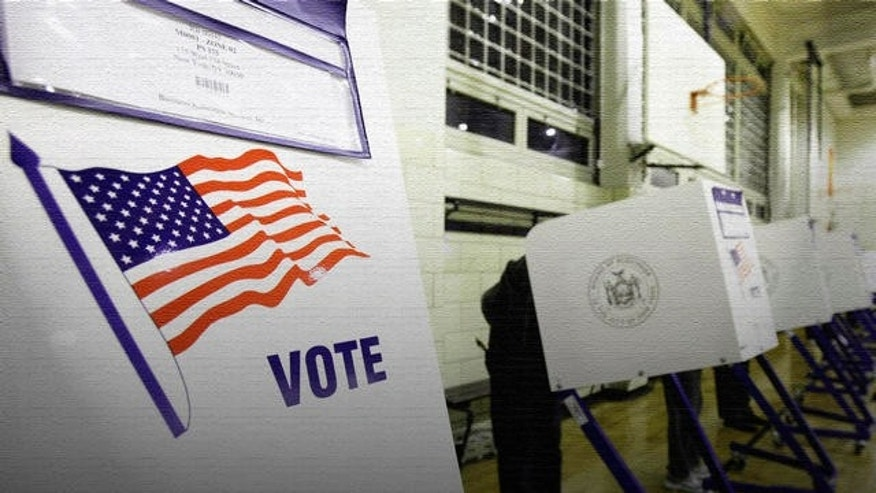 Voters cast their ballots in a school gym in New York's Harlem neighborhood,  Tuesday, Nov. 2, 2010. (AP Photo/Richard Drew)