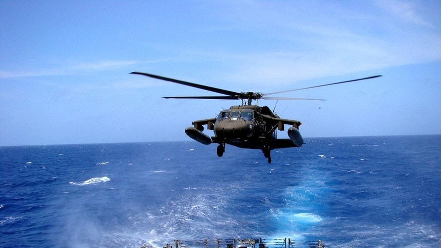 April 10, 2010:  An Army UH-60 Black Hawk helicopter practices landing aboard the USS Underwood off the coast of Honduras.