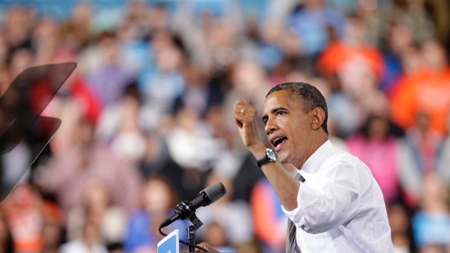 BOWLING GREEN, OH - SEPTEMBER 26: U.S. President Barack Obama speaks to supporters at the Stroh Center on September 26, 2012 in Bowling Green, Ohio. Six days before early voting starts in Ohio, the President discussed his plan to pay down the debt in a balanced way. (Photo by J.D. Pooley/Getty Images)