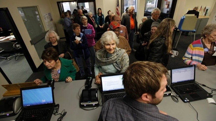 Sept. 27, 2012: Voters wait in line for their ballots during the first day of Iowa early voting at the Polk County Election Office in Des Moines, Iowa.