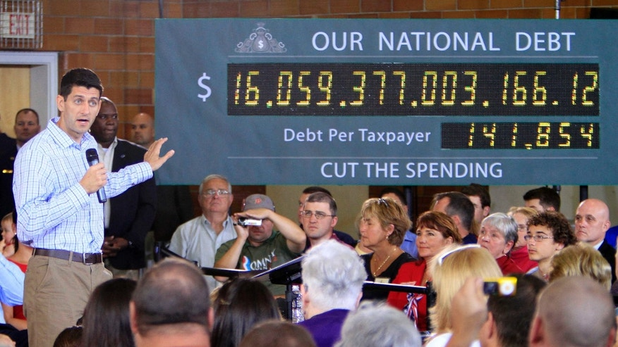 FILE: Sept. 18, 2012: GOP vice presidential nominee Rep. Paul Ryan, R-Wis., campaigns in Dover, N.H., with the national debt clock on stage.